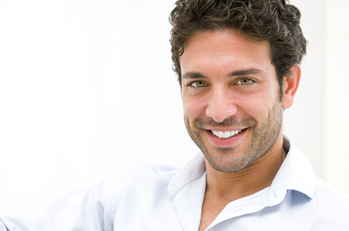 Man smiling about his cosmetic dental bonding byy his Owasso, OK dentist at Jillian Prather Family Dentistry.